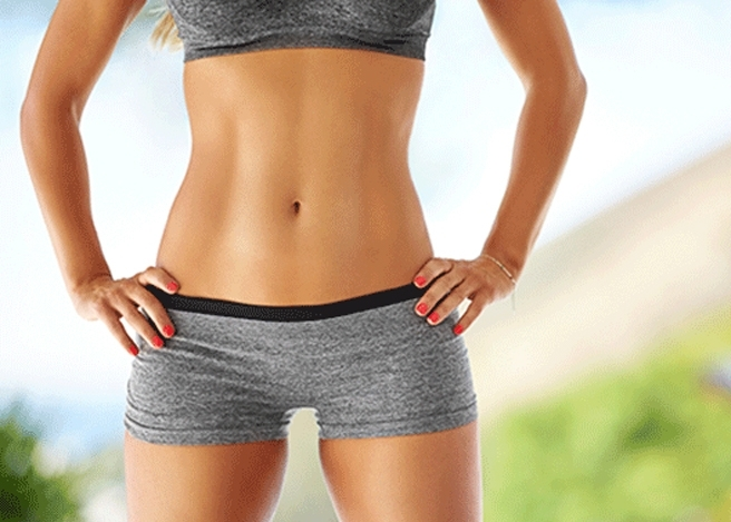 Fit woman with her hands on her hips.