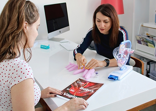 Dr Novikova explaining to a patient in her office.
