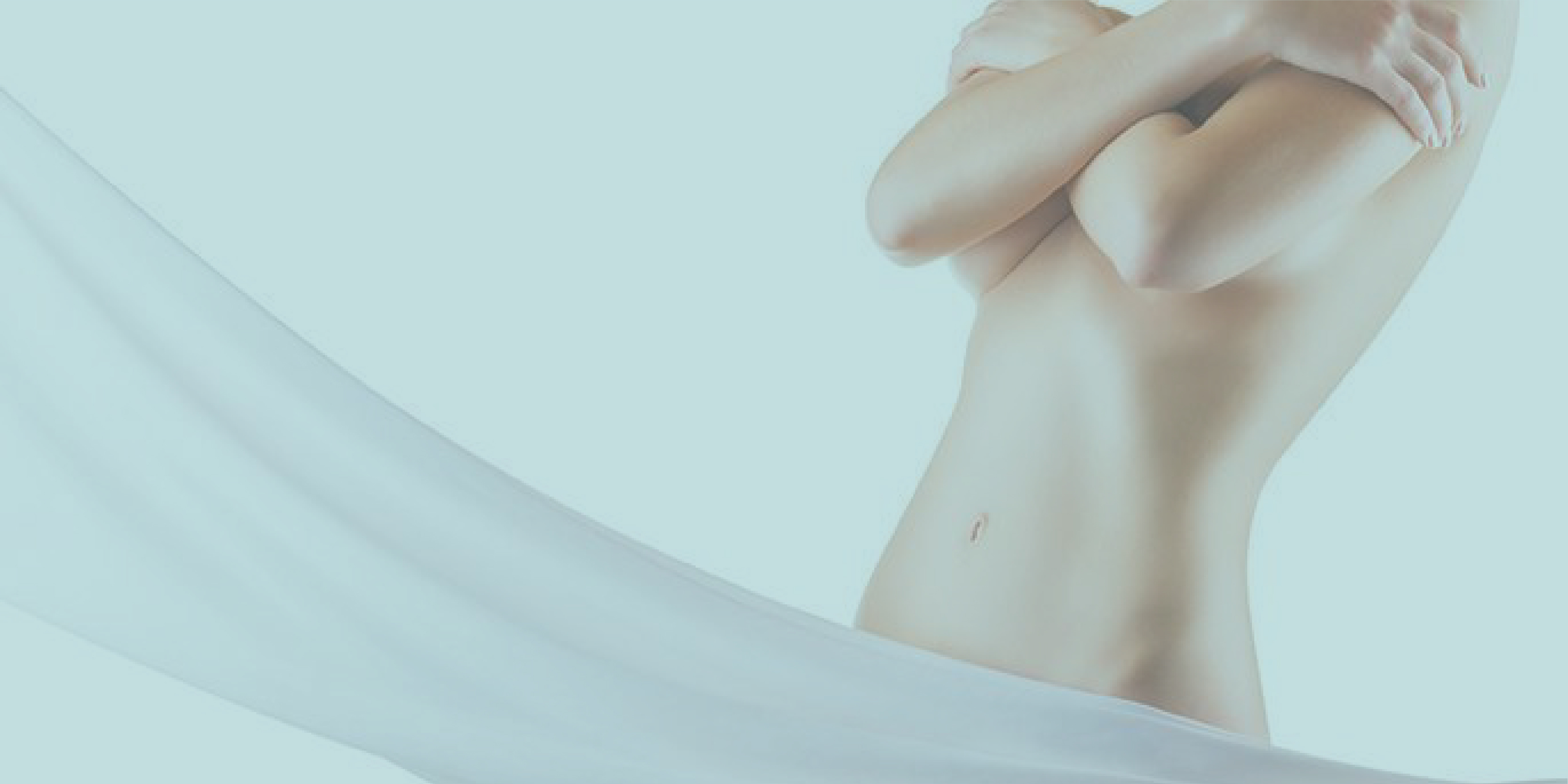 Woman holding her body with white cloth wrapped around her pelvic area.