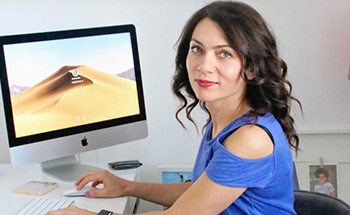 Dr Novikova at her desk infront of a computer