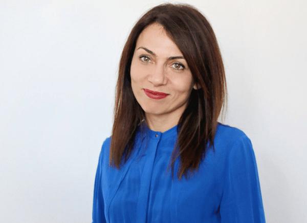 Dr Novikova a female doctor in a blue top